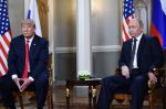 Russian President Vladimir Putin and U.S. President Donald Trump attend a meeting in Helsinki on July 16. (Brendan Smialowski/AFP/Getty Images)
