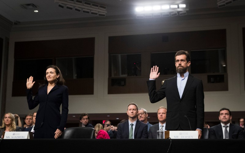 Facebook chief operating officer Sheryl Sandberg and Twitter chief executive officer Jack Dorsey testify during a Senate Intelligence Committee hearing  on Capitol Hill, September 5, 2018 in Washington, DC.  (Photo by Drew Angerer/Getty Images)