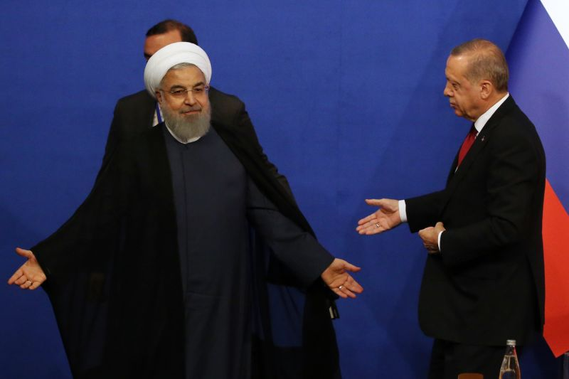 Iranian President Hassan Rouhani shrugs during a press conference with Turkish President Recep Tayyip Erdogan in Tehran on Sept. 7. (Mikhail Svetlov/Getty Images)
