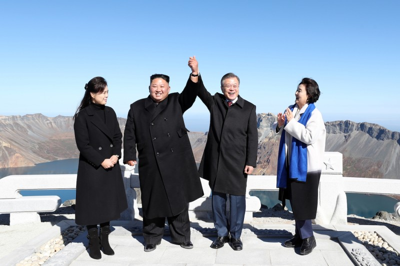 North Korean leader Kim Jong Un and his wife, Ri Sol Ju, pose with South Korean President Moon Jae-in and his wife, Kim Jung-sook, on the top of Mount Paektu on Sept. 20. (Photo by Pyeongyang Press Corps/Pool/Getty Images)