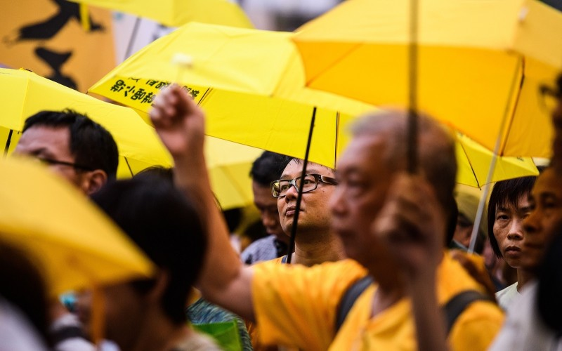 Activists use yellow umbrellas during a gathering outside the government headquarters to mark the fourth anniversary of mass pro-democracy rallies, known as the Umbrella Movement, in Hong Kong on September 28, 2018. ( ANTHONY WALLACE/AFP/Getty Images)
