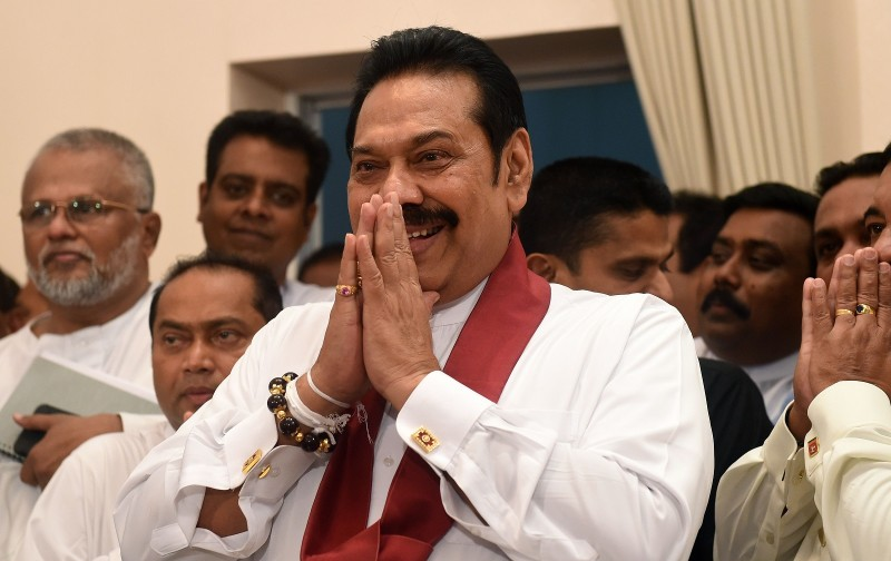 Sri Lanka's newly appointed prime minister, Mahinda Rajapaksa, gestures during a ceremony to assume duties at the prime minister's office in Colombo on Oct. 29. (Ishara S. Kodikara/AFP/Getty Images)