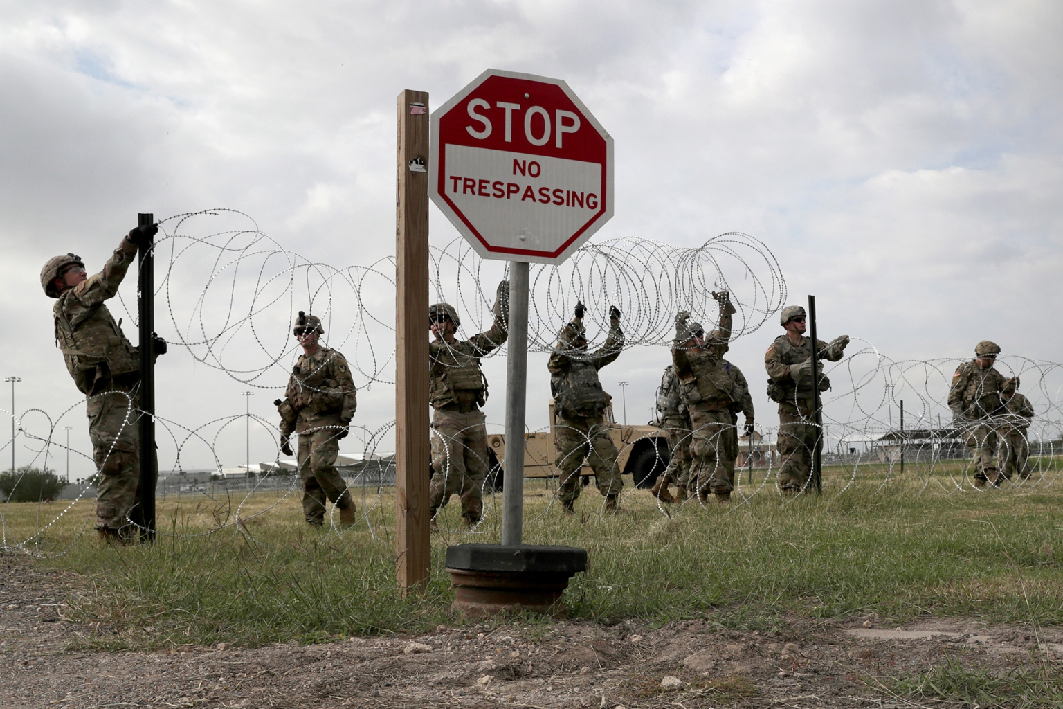 U.S. Army soldiers from Fort Riley, Kansas, string razor wire near the port of entry at the U.S.-Mexico border in Donna, Texas, on Nov. 4. President Trump ordered a surge in troops to the southern border ahead of the possible arrival of an immigrant caravan in upcoming weeks. John Moore/Getty Images