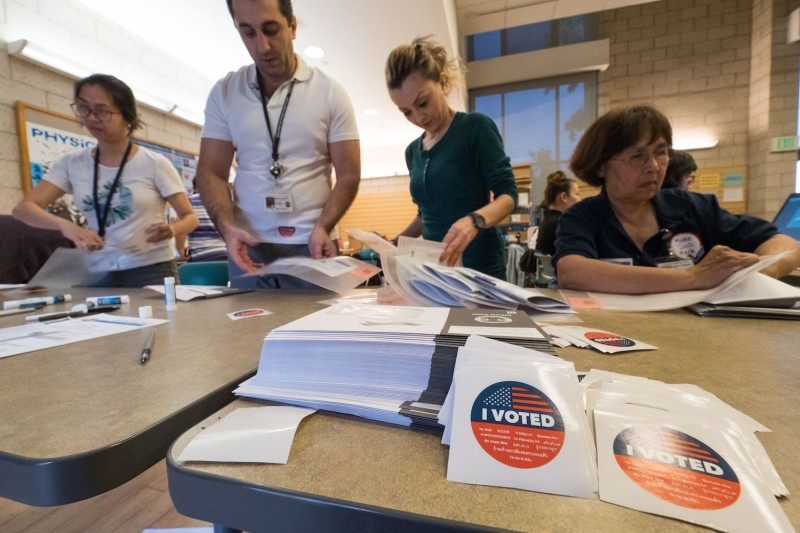 Poll workers help voters at polling station during early voting for the mid-term elections in the Lakeview Terrace neighborhood of Los Angeles, California on November 4, 2018. ROBYN BECK/AFP/Getty Images