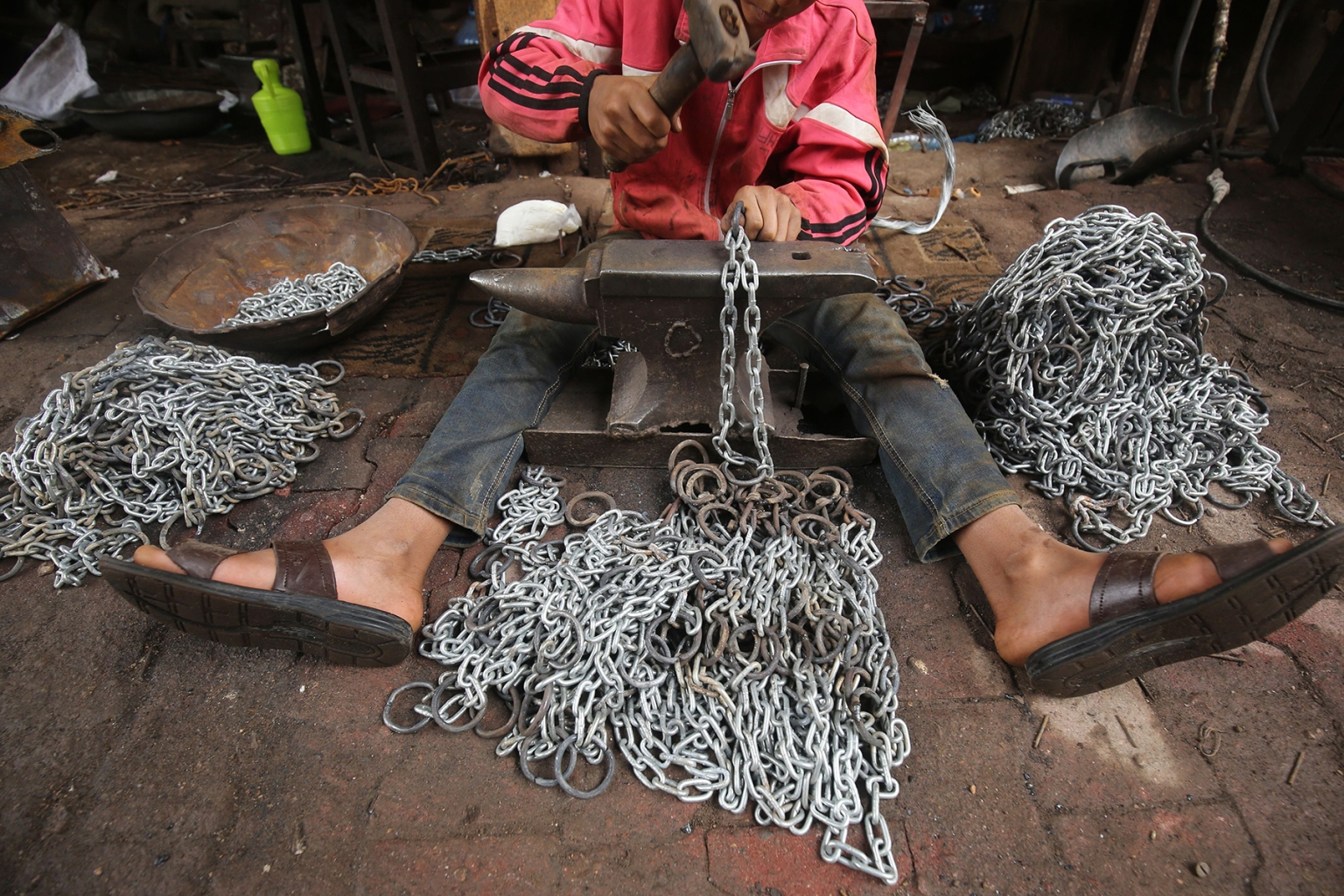 Ali Jawad, 12, who left school to support his family, works in an iron chains industry workshop on Haifa street in Baghdad, Iraq, on Nov.5. AHMAD AL-RUBAYE/AFP/Getty Images