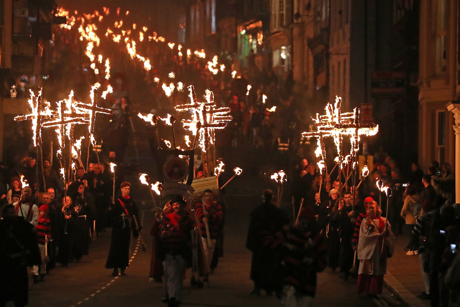 Revelers parade through the streets during the traditional Bonfire Night celebrations in Lewes, in East Sussex, southern England, on Nov. 5. Thousands of people attend the annual parade through the narrow streets until the evening comes to an end with the burning of an effigy usually representing Guy Fawkes, who died in 1605 after an unsuccessful attempt to blow up The Houses of Parliament. DANIEL LEAL-OLIVAS/AFP/Getty Images