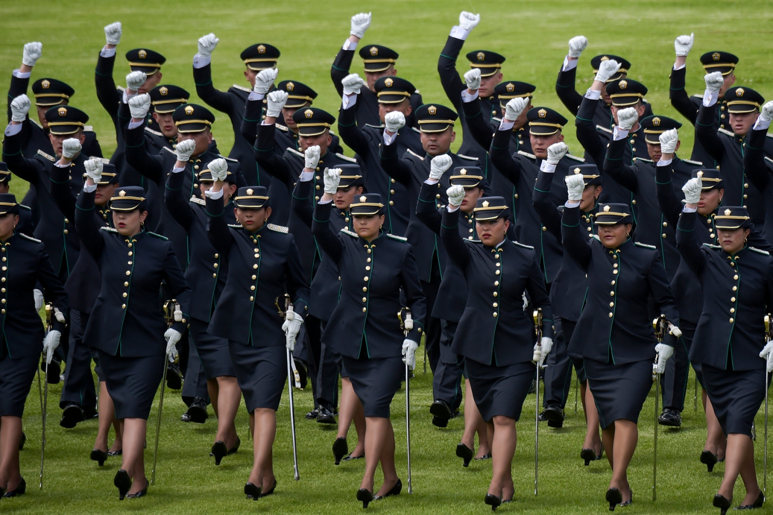 Newly graduated police officers attend the 127th anniversary of the Colombian Police at the General Santander police school in Bogota on Nov. 6. RAUL ARBOLEDA/AFP/Getty Images