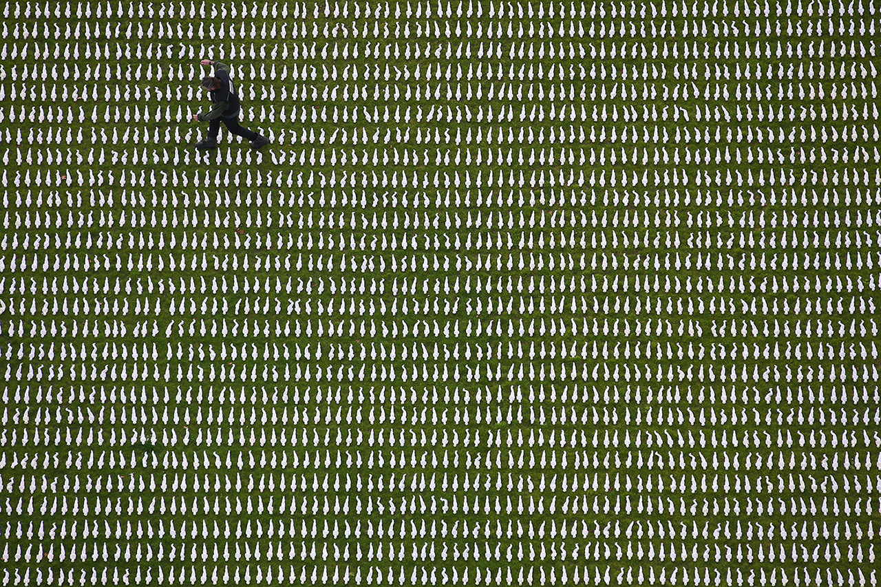 "British artist Rob Heard poses among 72,396 shrouded figures, which form his installation ""Shrouds of the Somme"" at Queen Elizabeth Olympic Park in London on Nov. 7. The figures represent Commonwealth servicemen who died at the Somme who have no known grave and are on display to mark the 100th anniversary of the end of World War I. DANIEL LEAL-OLIVAS/AFP/Getty Images"