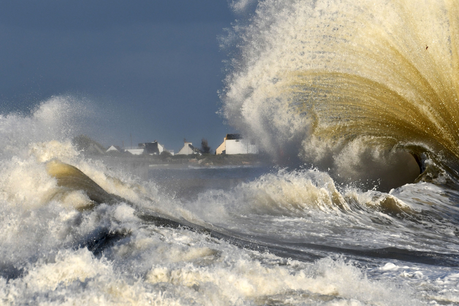 Waves break in the port of Lesconil, western France, on Nov. 7. FRED TANNEAU/AFP/Getty Images