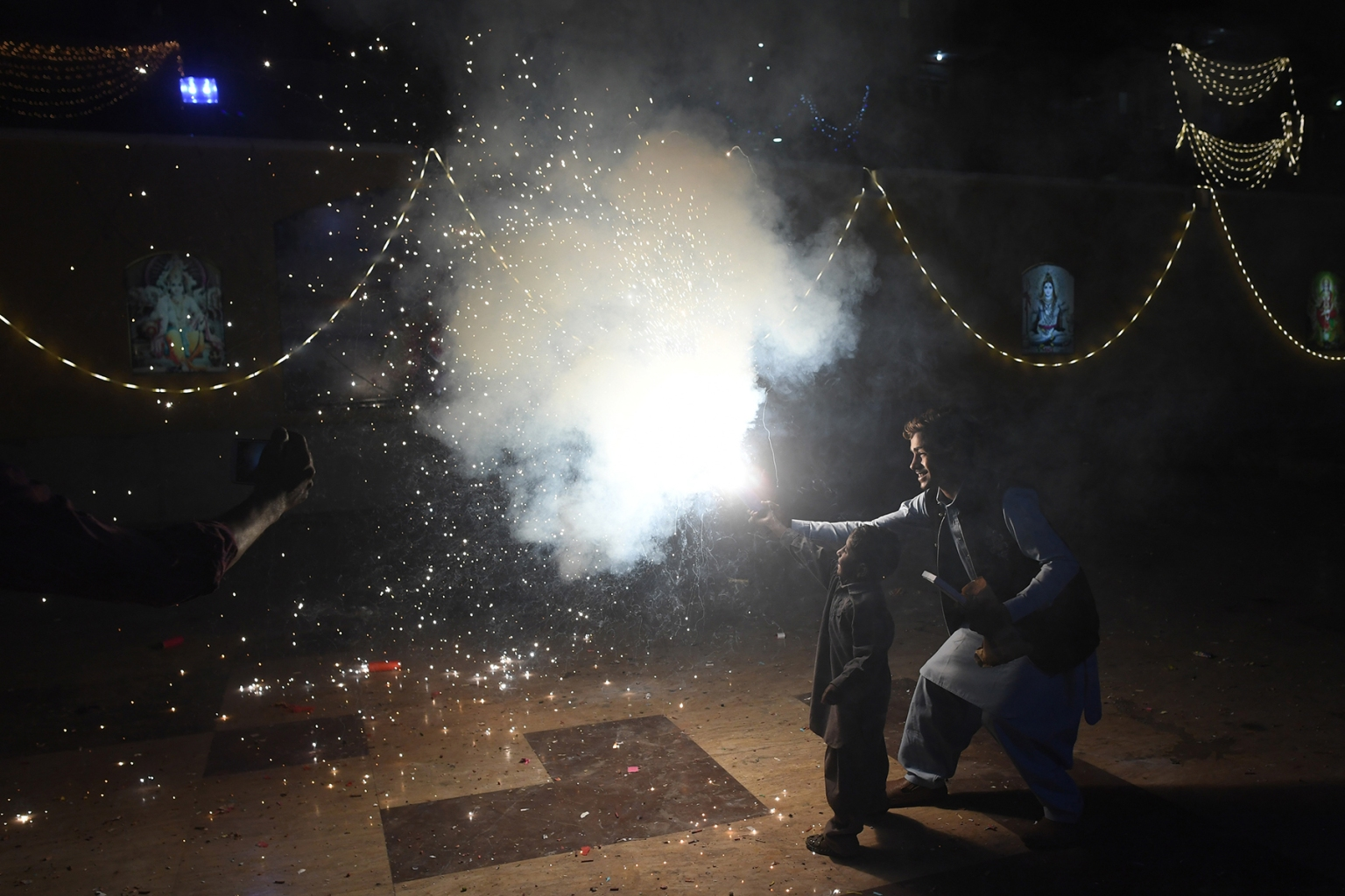 A Pakistani Hindu lights firecrackers during Diwali Festival celebrations in Karachi on Nov. 7. ASIF HASSAN/AFP/Getty Images