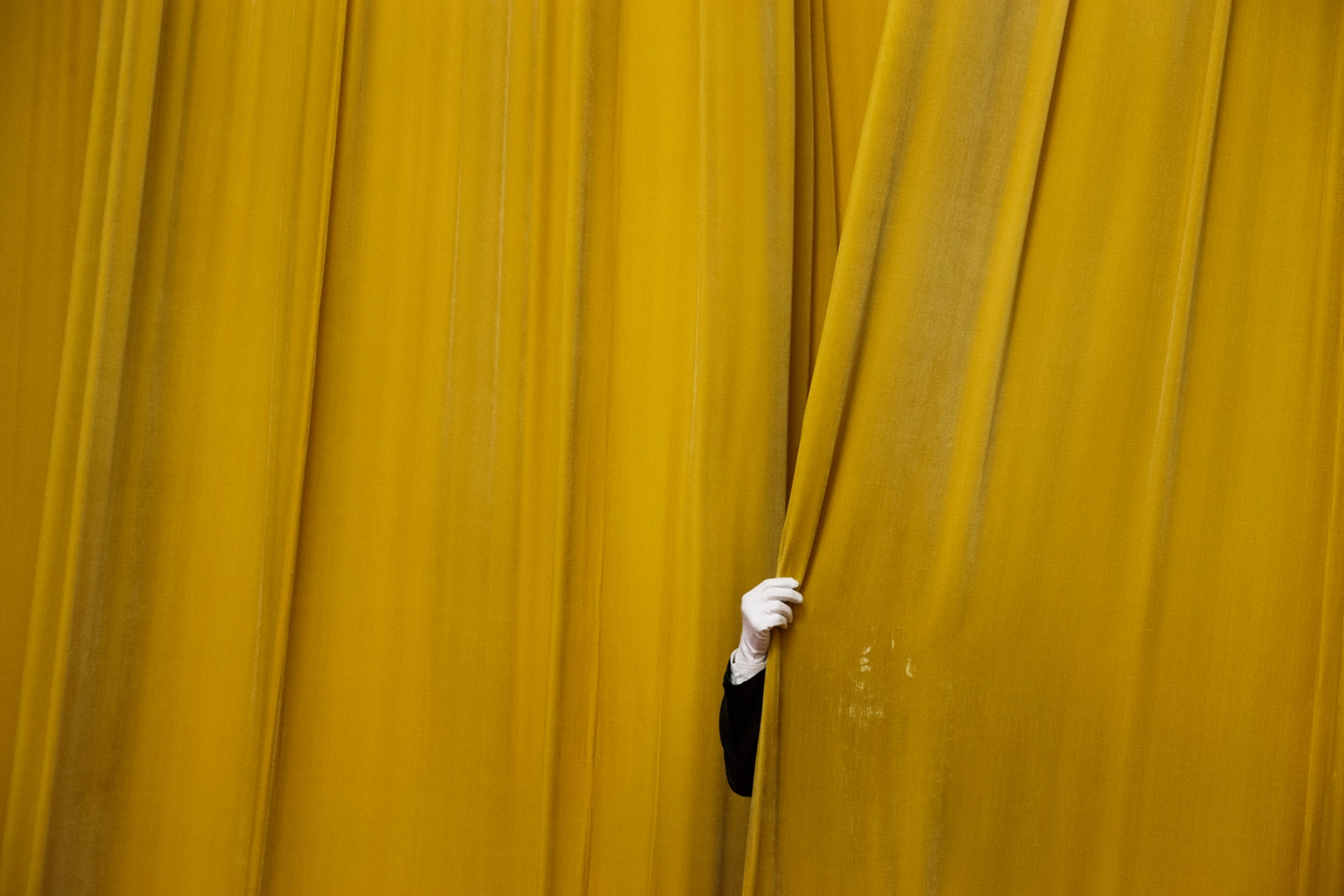 A security official closes a curtain at the Great Hall of the People before a meeting between former U.S. Secretary of State Henry Kissinger and China's President Xi Jinping in Beijing on Nov. 8. THOMAS PETER/AFP/Getty Images
