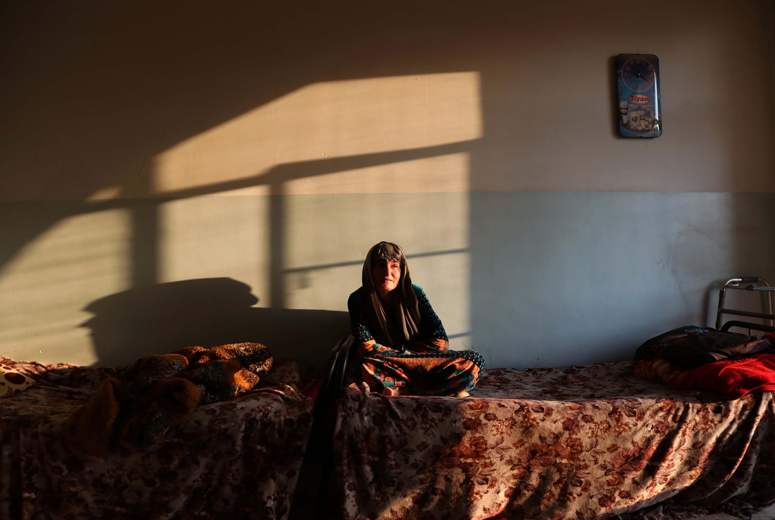 An Iraqi Kurdish woman sits in a house run by an NGO that takes care of people abandoned by their families in the northern Iraqi city of Arbil, on Nov. 8. SAFIN HAMED/AFP/Getty Images