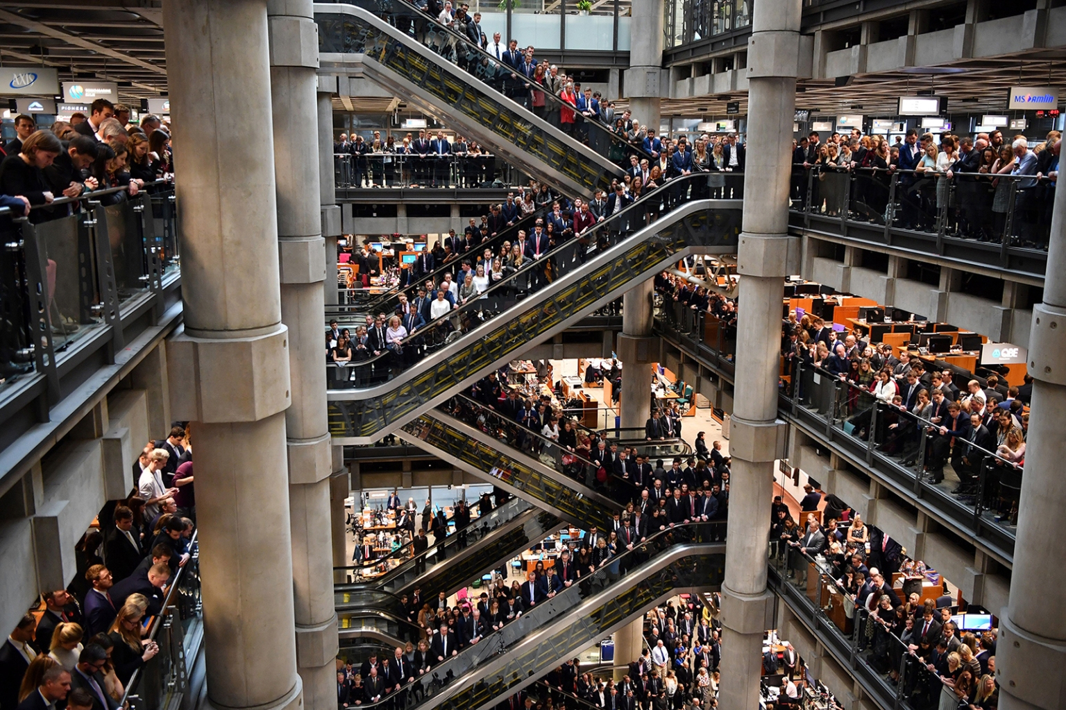 Employees observe a minute of silence in commemoration of Remembrance Day inside Lloyd's of London on Nov. 9. In the run-up to Armistice Day, many Britons wear a paper red poppy—symbolizing the poppies that grew on French and Belgian battlefields during World War I. BEN STANSALL/AFP/Getty Images