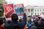 Demonstrators gathered in front of the White House to protest U.S. President Donald Trump's decision to terminate temporary protected status for citizens of Sudan, El Salvador, Haiti, and Nicaragua in Washington, D.C. on Nov. 9. (Nicholas Kamm/AFP/Getty Images)