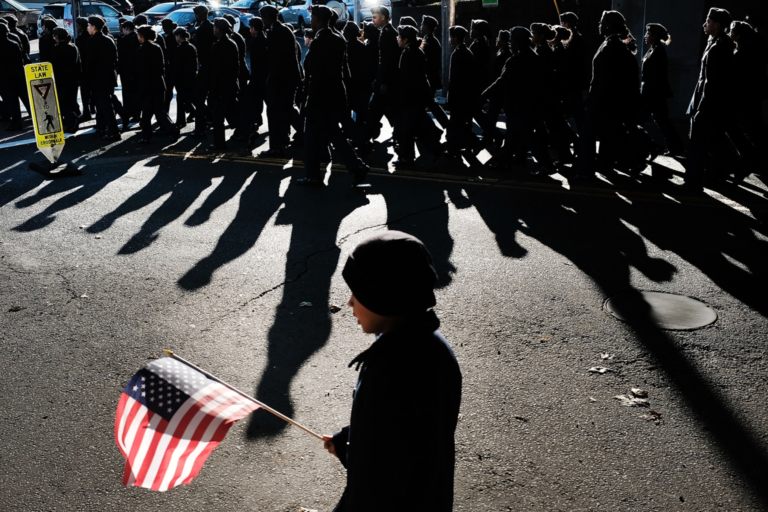 A child holds an American Flag as the Veterans Day Parade passes in Milford, Connecticut, on Nov. 11. This year's Veterans Day had added significance as it marks the 100th anniversary of the end of World War I. Spencer Platt/Getty Images