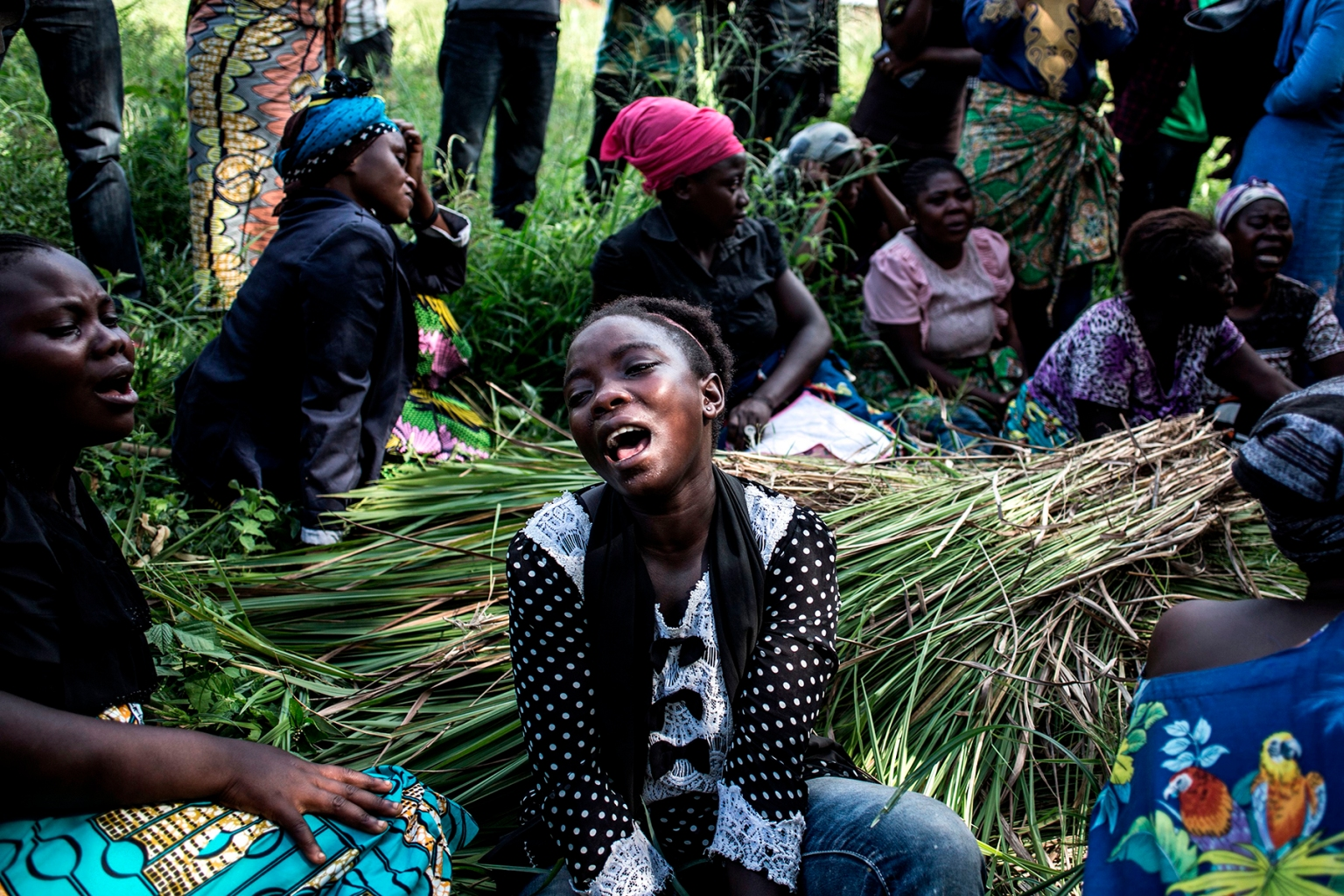 Family members of a woman killed in an attack blamed on the Ugandan Allied Democratic Forces rebel group mourn at her burial in Beni, Democratic Republic of Congo, on Nov. 12. Rebels were accused of killing six people, hacking one woman to death, and kidnapping five others—mostly children—in the Democratic Republic of Congo's restive east, officials said. JOHN WESSELS/AFP/Getty Images