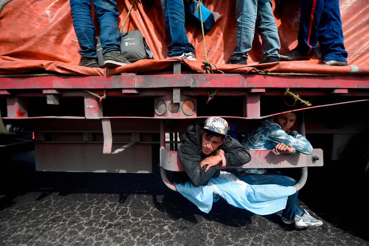 Central American migrants moving towards the United States ride aboard a truck from La Piedad to Vista Hermosa, Mexico, as they continue their trek north on Nov. 12. ALFREDO ESTRELLA/AFP/Getty Images