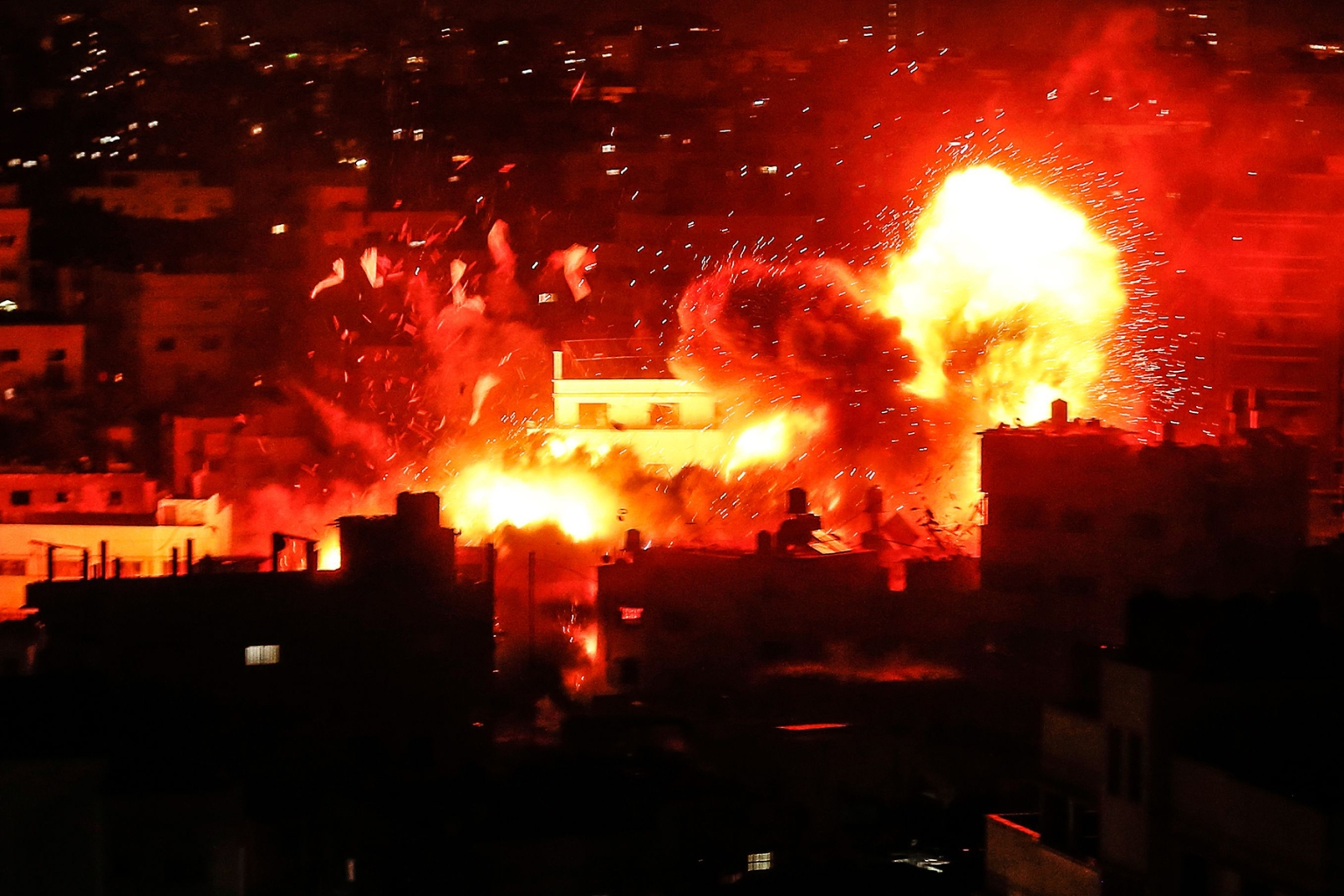 A ball of fire shoots above the building housing the Hamas-run television station al-Aqsa TV in the Gaza Strip during an Israeli airstrike on Nov. 12. MAHMUD HAMS/AFP/Getty Images