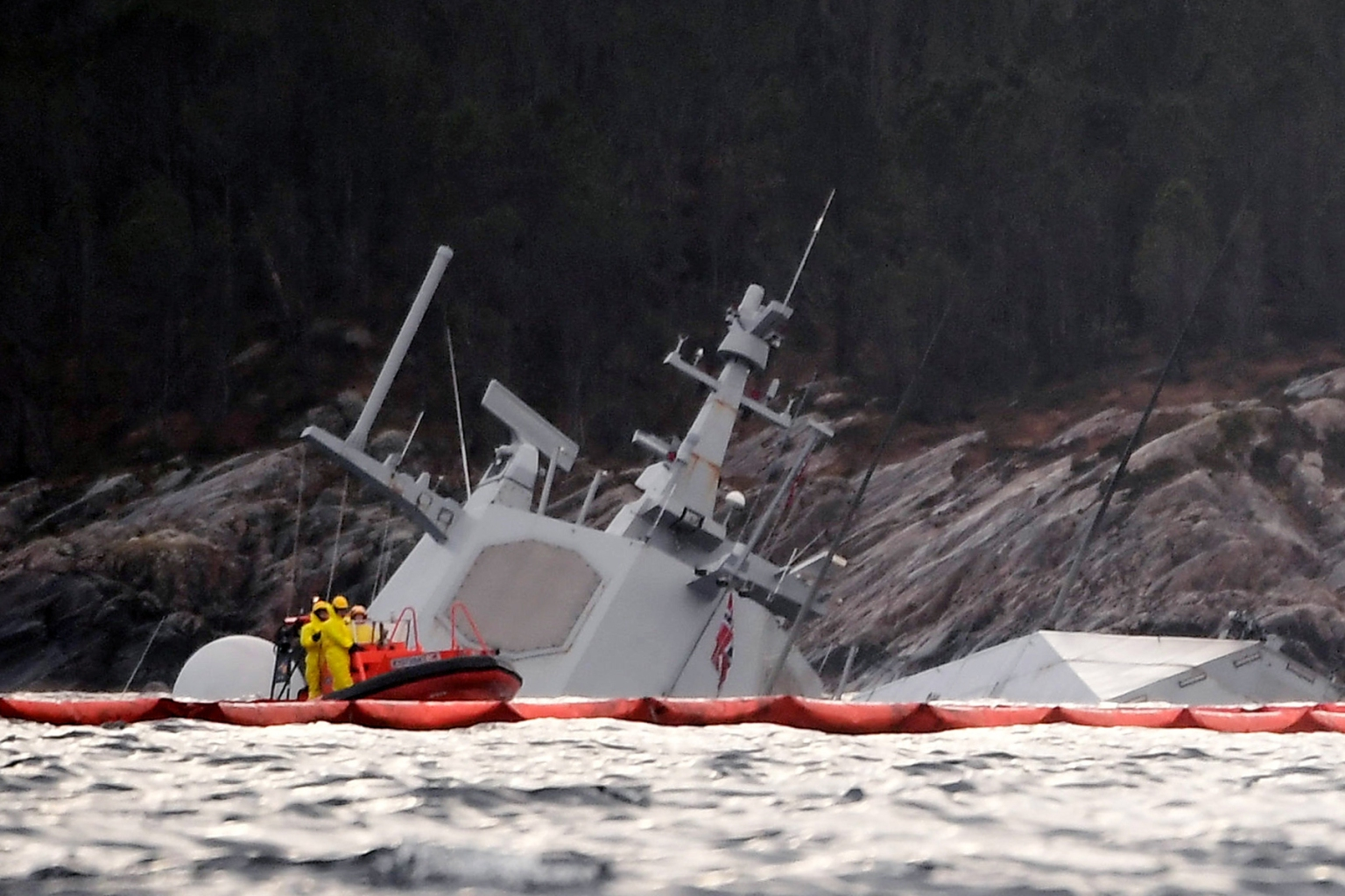 The Norwegian frigate KNM Helge Ingstad is seen partly underwater in the sea near Bergen, western Norway, on Nov. 13. The frigate capsized after collision with a tank ship on Nov. 8. MARIT HOMMEDAL/AFP/Getty Images