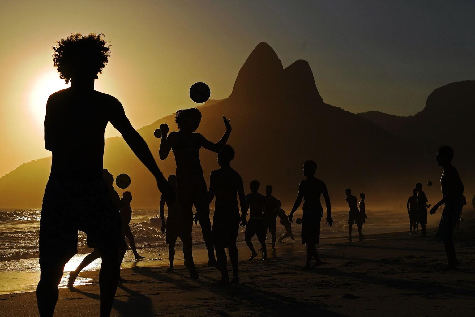 Youth play football at Ipanema beach in Rio de Janeiro, Brazil, on Nov. 13. CARL DE SOUZA/AFP/Getty Images