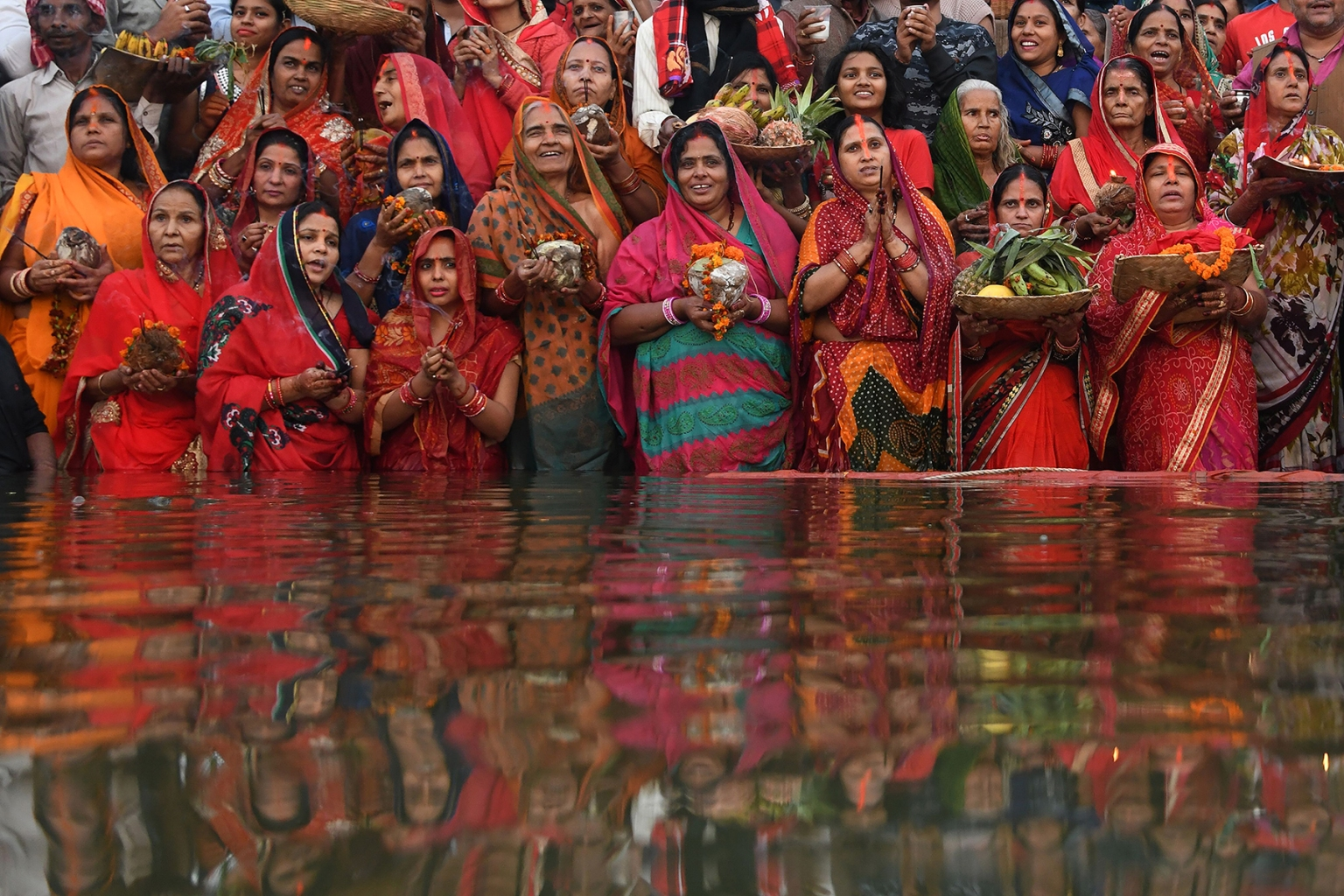Indian devotees take part in a ritual worshipping the sun god during the Chhath Festival on the banks of the holy river Ganges in Varanasi on Nov. 14. The festival is observed in parts of India and Nepal when devotees undergo a fast and offer water and milk to the sun god at dawn and dusk on the banks of rivers or small ponds, praying for the longivety and health of their spouses. DOMINIQUE FAGET/AFP/Getty Images