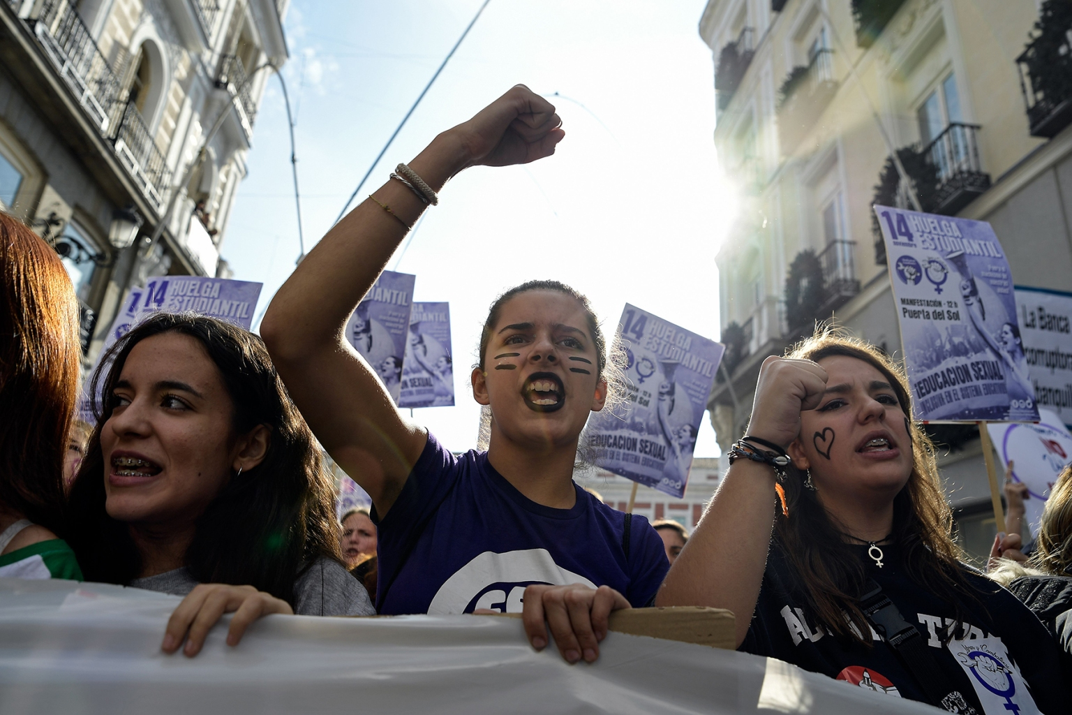 Spanish protesters hold placards and shout slogans during a demonstration against machismo and sexism in classrooms, marking a strike day called by students in Madrid on Nov. 14. OSCAR DEL POZO/AFP/Getty Images