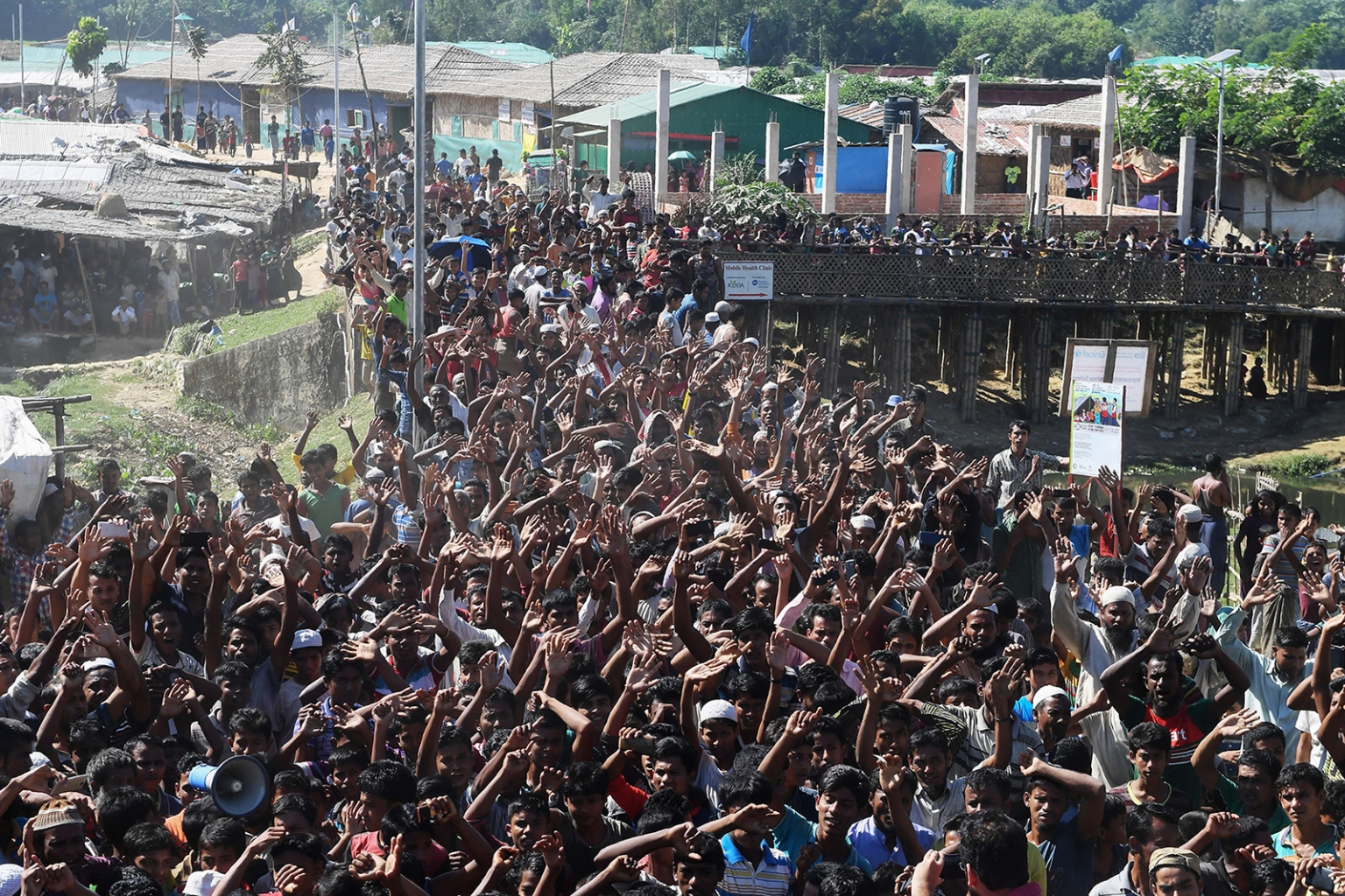 Rohingya refugees shout slogans at a protest against a disputed repatriation program at the Unchiprang refugee camp near Teknaf, Bangladesh, on Nov. 15. Frightened and angry refugees forced Bangladesh to call off efforts to start sending back some of the hundreds of thousands of stateless Muslims to Myanmar. DIBYANGSHU SARKAR/AFP/Getty Images