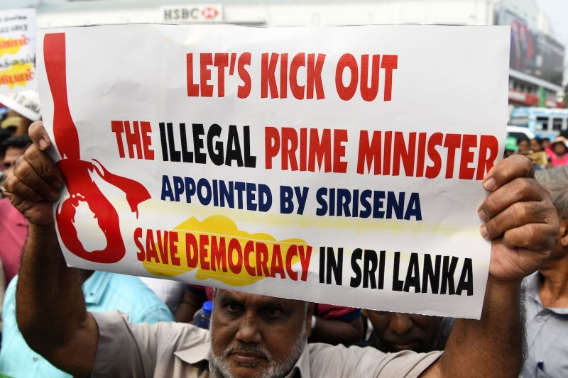 A supporter of ousted Prime Minister Ranil Wickremesinghe protests at a rally in Colombo, Sri Lanka on Nov. 15. (Lakruwan Wanniarachchi/AFP/Getty Images)