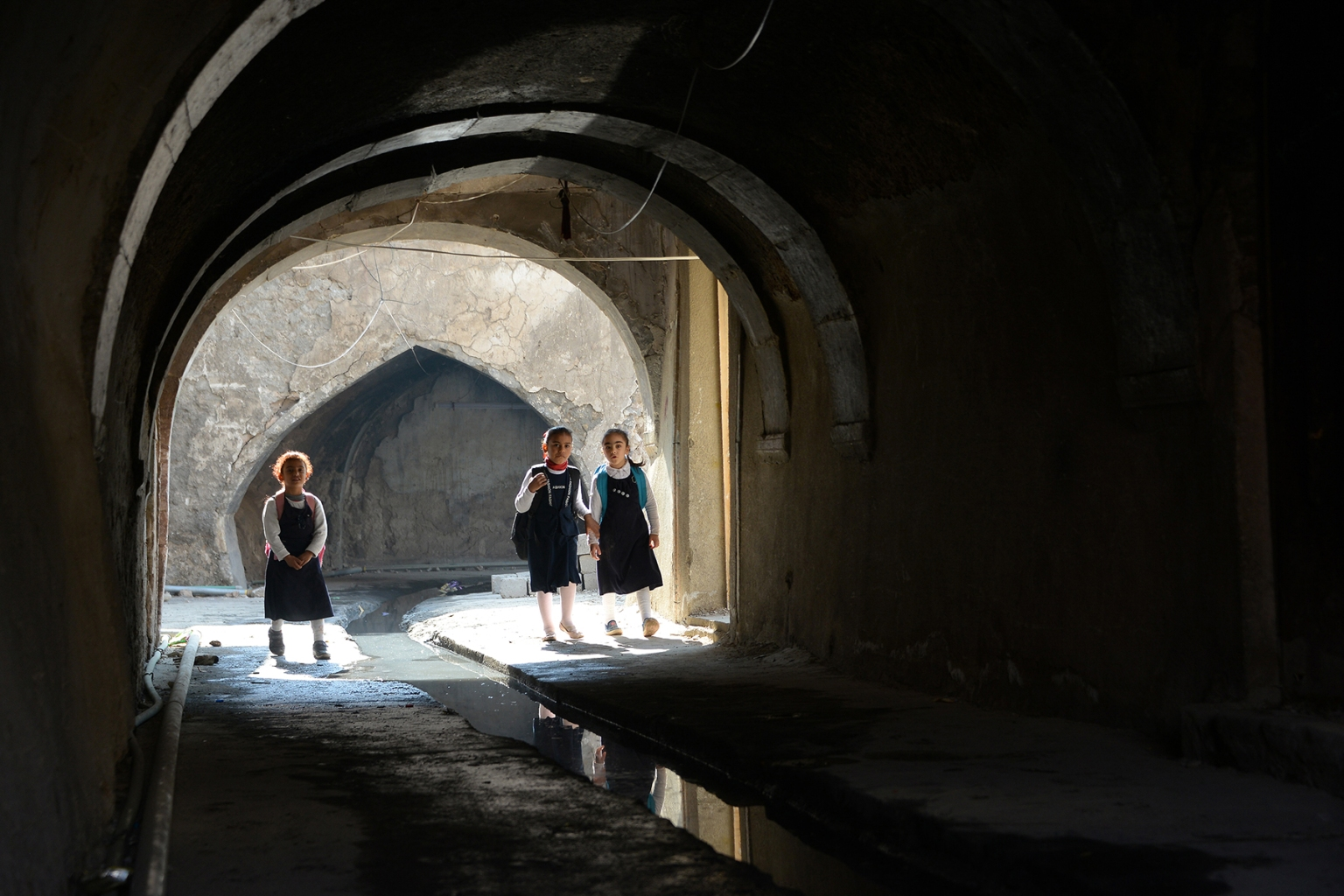 Iraqi children walk through the arcades of the old city in Mosul, the capital of Iraq's northern Nineveh province, on Nov. 12. ZAID AL-OBEIDI/AFP/Getty Images