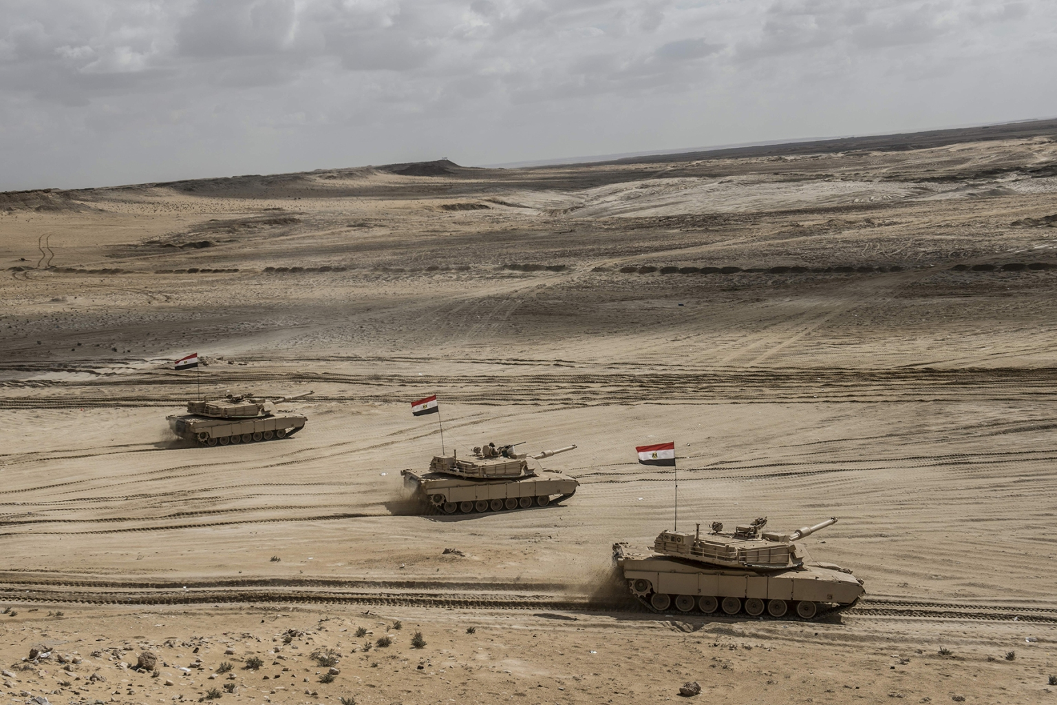 Egyptian tanks take part in Arab Shield military exercises art Matrouh Governorate Mohamed Naguib miilitary base, northwest of Cairo, on Nov. 15. Forces from Saudi Arabia, Egypt, the UAE, Kuwait, Bahrain, and Jordan are taking part in the maneuvers. KHALED DESOUKI/AFP/Getty Images