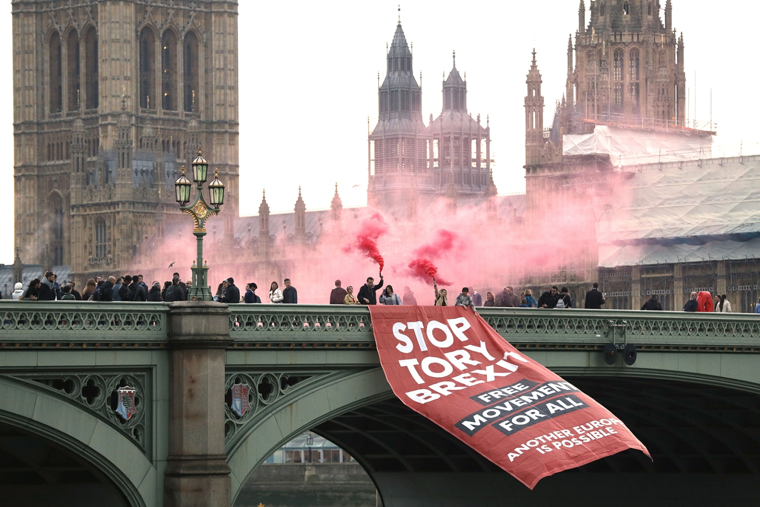 Anti-Brexit campaigners unfurl a banner on Westminster bridge in front of the Houses of Parliament in London on Nov. 15. ADRIAN DENNIS/AFP/Getty Images