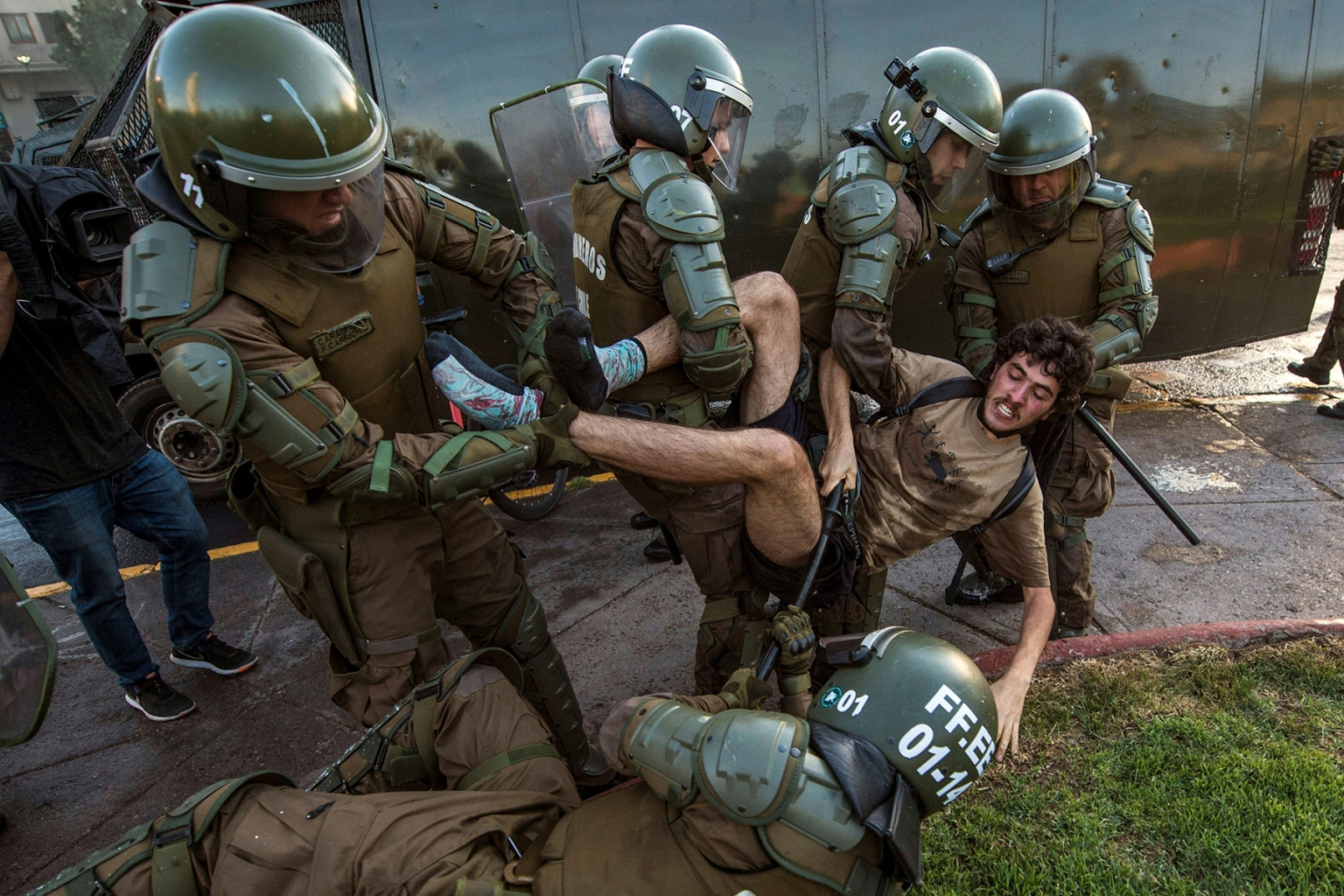 A demonstrator is arrested by riot police during a protest for the death of Mapuche Camilo Catrillanca in Santiago, Chile, on Nov. 15. The 24-year-old Catrillanca was shot and killed during a police operation in an indigenous community in the Araucania region, the center of the Mapuche conflict, according to police reports. MARTIN BERNETTI/AFP/Getty Images