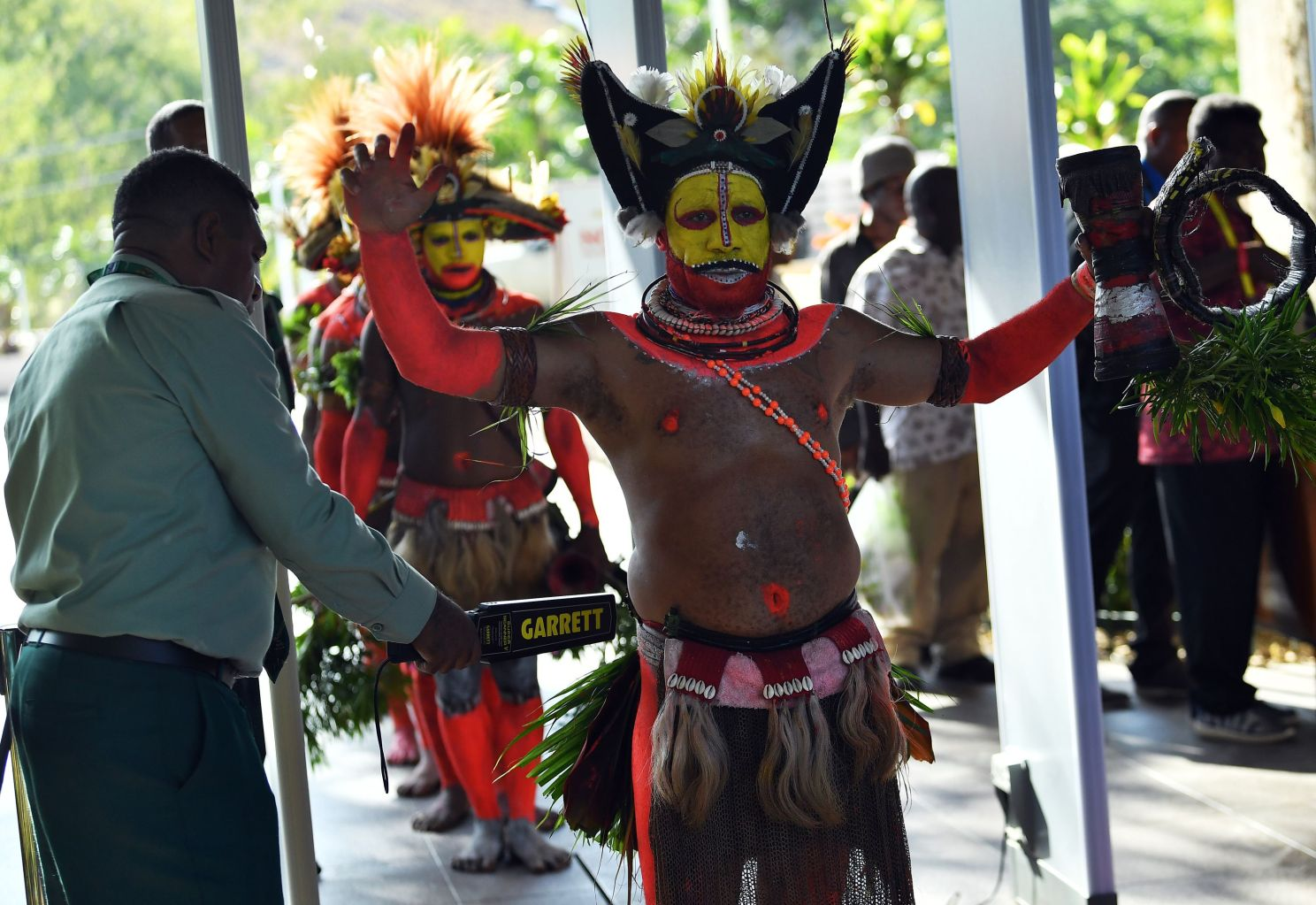Papuan villagers in traditional costume go through the security screening at Parliament House in Port Moresby ahead of Asia-Pacific Economic Cooperation (APEC) Summit on on Nov. 16. SAEED KHAN/AFP/Getty Images