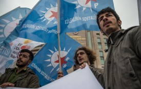 Demonstrators hold flags and chant slogans during a protest in front of the Istanbul courthouse in support of Turkish-German journalist Adil Demirci during his trial on Nov. 20. (Bulent Kilic/AFP/Getty Images)