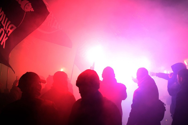 Far-right activists hold flares during a rally in support of martial law and cutting ties with Russia in front of the Ukrainian parliament in Kiev on Nov. 26. (Sergei Supinsky/AFP/Getty Images)
