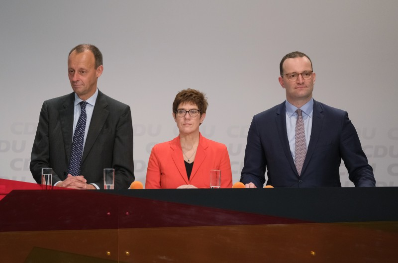 Annegret Kramp-Karrenbauer, Jens Spahn, and Friedrich Merz at a regional German Christian Democratic Union gathering in Halle, Germany, on Nov. 22. (Sean Gallup/Getty Images)