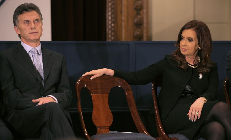 Cristina Fernandez de Kirchner looks at Argentine President Mauricio Macri, before delivering a speech in Buenos Aires on Aug. 2, 2012. (Juan Mabromata/AFP/Getty Images)