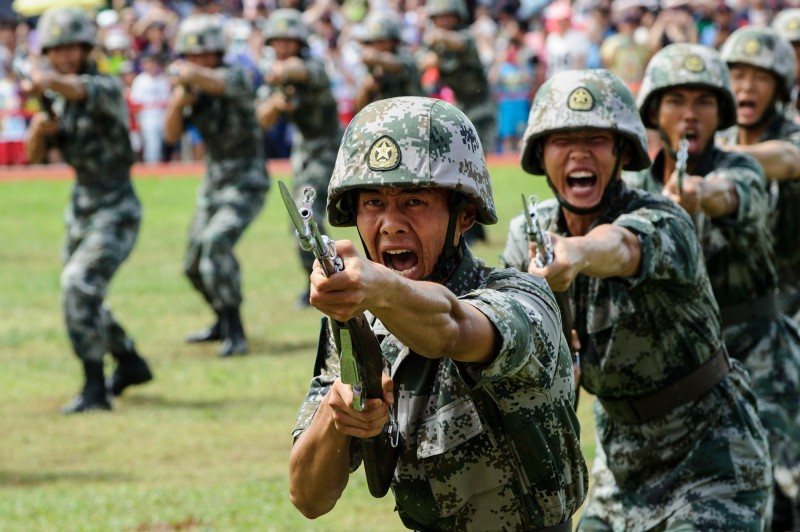 Chinese People's Liberation Army soldiers in a demonstration at the opening day of the navy base at Stonecutters Island in Hong Kong on July 1, 2016. (Anthony Wallace/AFP/Getty Images)