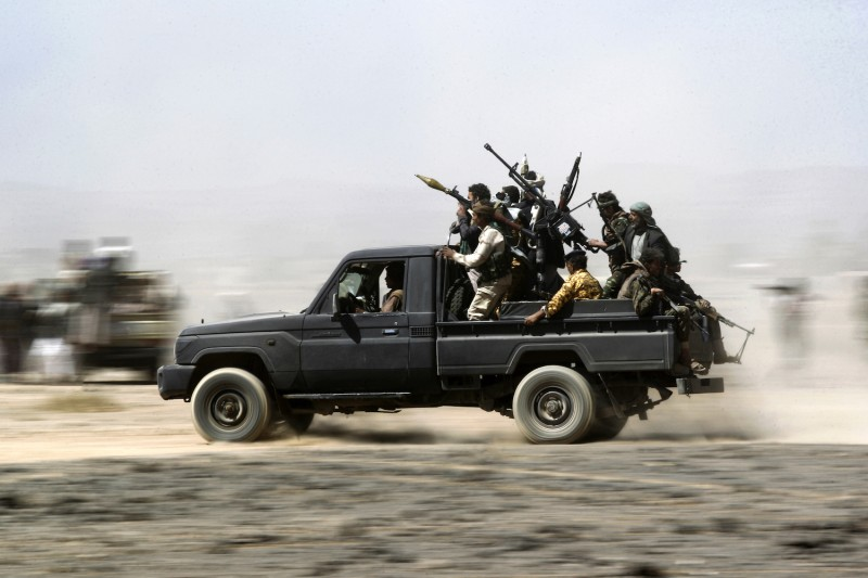 Armed Yemeni tribesmen loyal to the Shiite Houthi rebels sit in the back of an armed vehicle during a gathering to mobilize more fighters into several battlefronts on the outskirts of the capital, Sanaa, on Nov. 1, 2016. (Mohammed Huwais/AFP/Getty Images)
