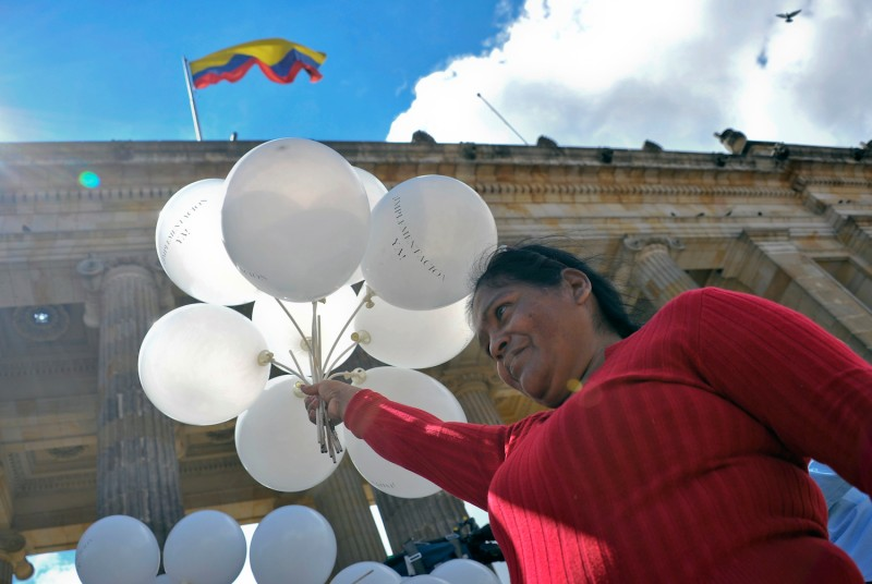 A woman holds white balloons during a demonstration to demand the endorsement of the peace agreement between the Colombian government and the Revolutionary Armed Forces of Colombia in Bogota on Nov. 30. (Guillermo Legaria/AFP/Getty Images)