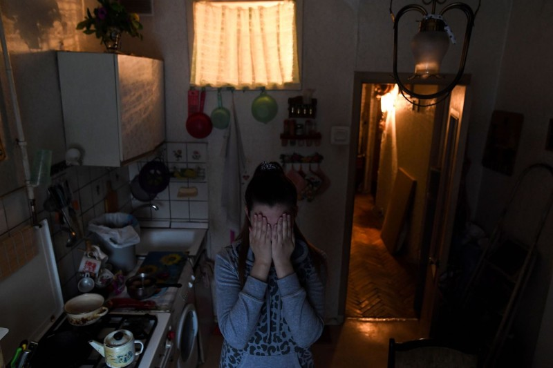 A 26-year-old victim of domestic violence poses for pictures in Moscow on Feb. 3, 2017. (Kirill Kudryavtsev/AFP/Getty Images)