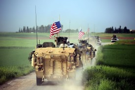 U.S. forces, accompanied by the Kurdish People's Protection Units (YPG), drive armored vehicles near the northern Syrian village of Darbasiyah on April 28, 2017. (Delil Souleiman/AFP/Getty Images)