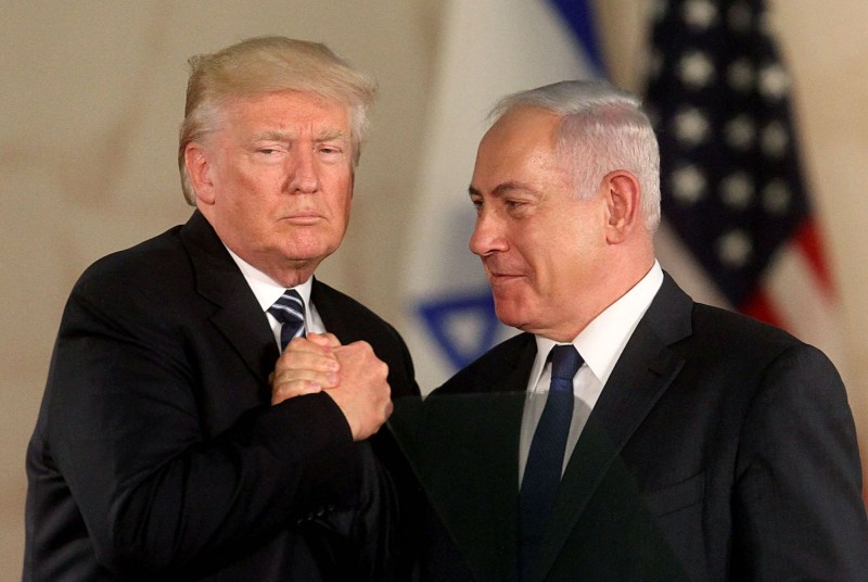 U.S. President Donald Trump and Israeli Prime Minister Benjamin Netanyahu shake hands at the Israel Museum in Jerusalem on May 23, 2017. (AFP/Getty Images)