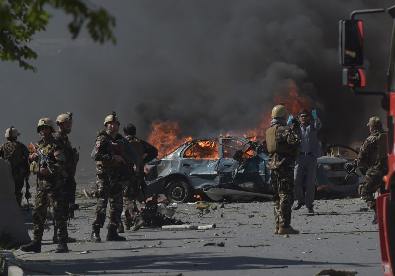 Afghan security forces personnel are seen at the site of a car bomb attack in Kabul on May 31, 2017. (Shah Marai/AFP/Getty Images)