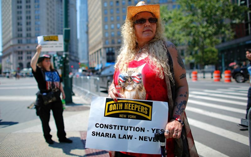 A Trump supporter holds up a sign during an  anti-sharia law rally organized by ACT for America on June 10 2017 in New York. (KENA BETANCUR/AFP/Getty Images)