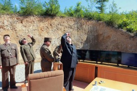 North Korean leader Kim Jong Un inspects the successful test-fire of the intercontinental ballistic missile Hwasong-14 at an undisclosed location on July 4, 2017. (STR/AFP/Getty Images)