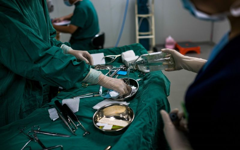 In this photograph taken on August 22, 2017, doctors prepare instruments during a patient's plastic surgery procedure at Huamei Medical Cosmetology Hospital in Shanghai. (CHANDAN KHANNA/AFP/Getty Images)
