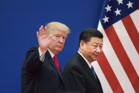 U.S. President Donald Trump and Chinese President Xi Jinping leave an event at the Great Hall of the People in Beijing on Nov. 9, 2017. (Nicolas Asfouri/AFP/Getty Images)