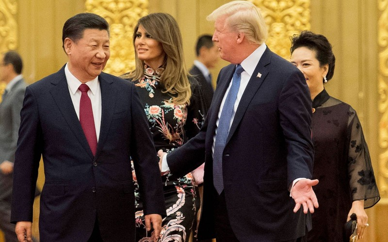 US President Donald Trump speaks to China's President Xi Jinpingin the Great Hall of the People in Beijing on November 9, 2017.      (JIM WATSON/AFP/Getty Images)