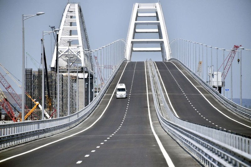 A vehicle runs down the 19 km road-and-rail Crimean Bridge passing over the Kerch Strait and linking southern Russia to the Crimean peninsula on May 15, 2018, in Kerch, prior to the opening ceremony.  ALEXANDER NEMENOV/AFP/Getty Images